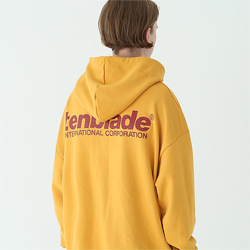 international print hoodie mustard